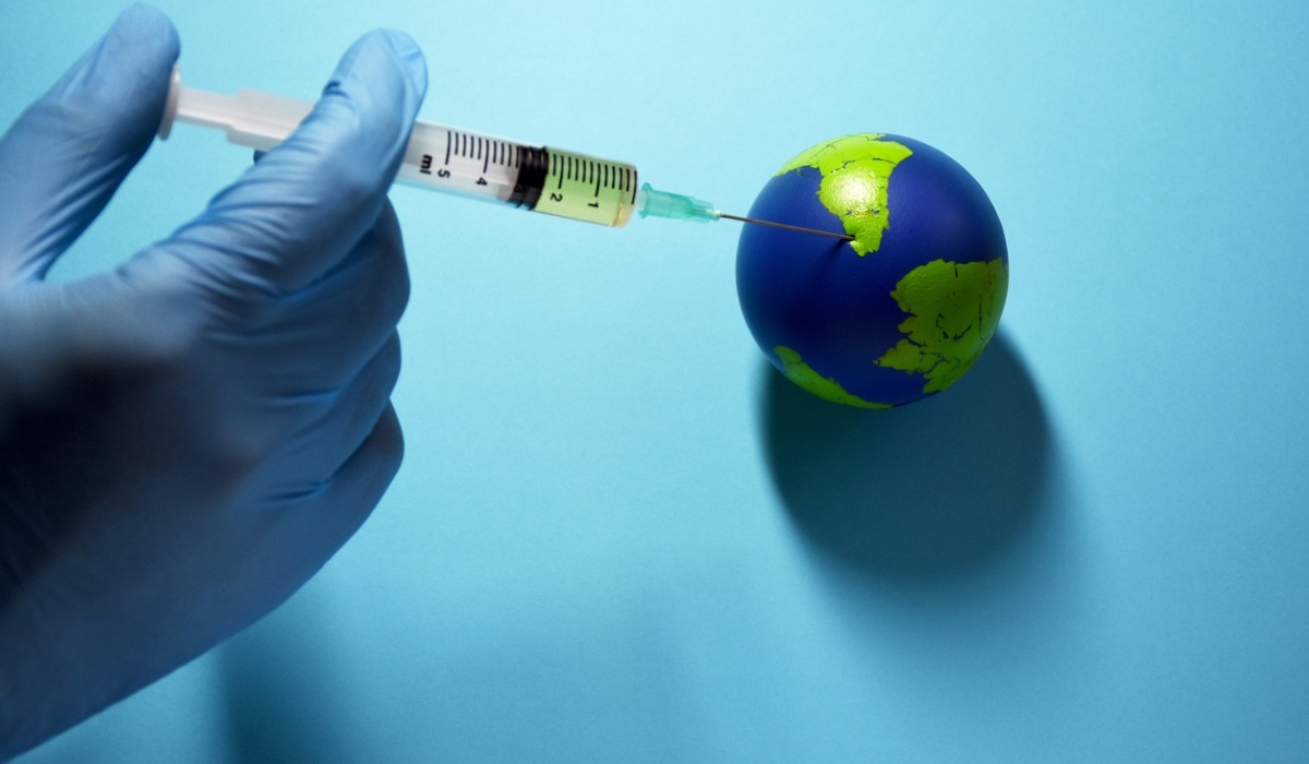 global-vaccination-doctor-makes-an-injection-to-planet-earth-picture-id1216668544
