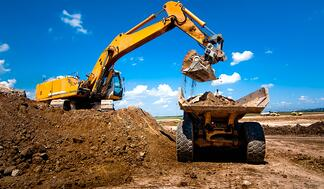 industrial-truck-loader-excavator-moving-earth-and-unloading-int-picture-id474445139